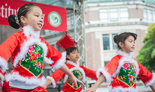 Children performing in traditional costume